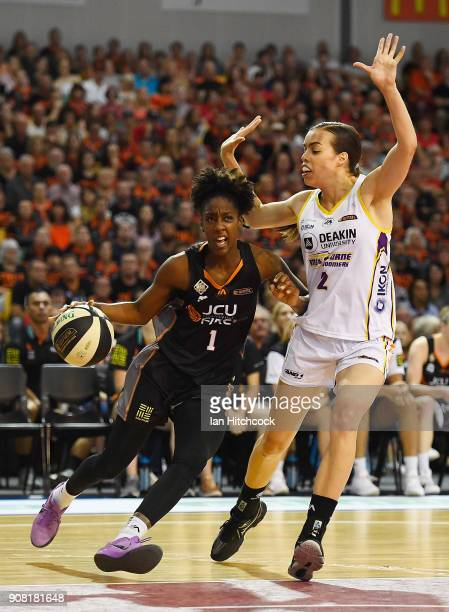Laurin Mincy of the Fire drives to the basket past Louella Tomlinson of the Boomers during game three of the WNBL Grand Final series between the...