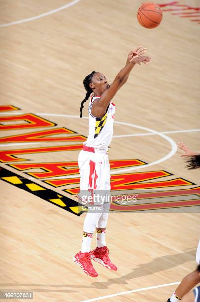 Laurin Mincy of the Maryland Terrapins shoots the ball against the Delaware State Hornets at the Comcast Center on December 14 2013 in College Park...