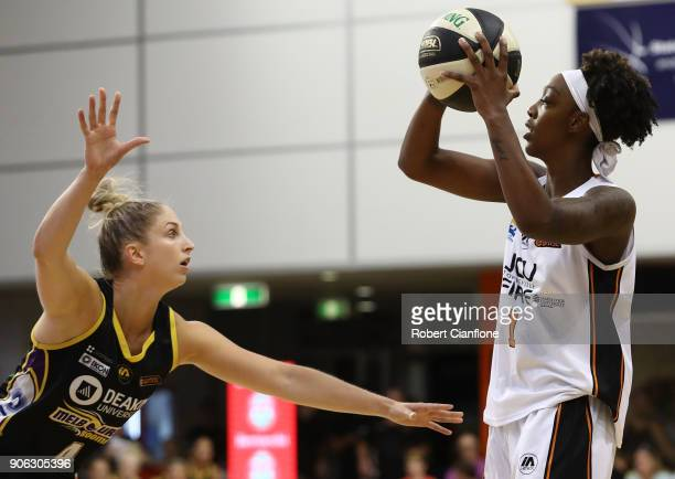 Laurin Mincy of the Townsville Fire is pressured by Rebecca Cole of the Melbourne Boomers during game two of the WNBL Grand Final series between the...