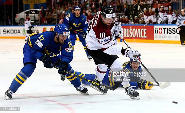 Lauris Darzins of Latvia and Jimmie Eriksson of Sweden battle for the puck during the IIHF World Championship group A match between Latvia and Sweden...