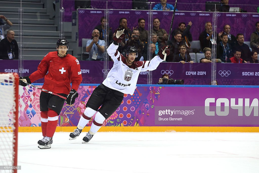 Lauris Darzins #10 of Latvia celebrates after scoring an open net goal late in the third period against Switzerland during the Men's Ice Hockey Qualification Playoff game on day eleven of the Sochi 2014 Winter Olympics at Bolshoy Ice Dome on February 18, 2014 in Sochi, Russia.