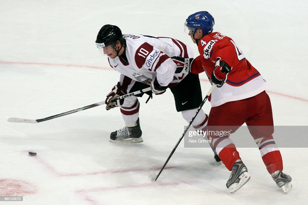 Lauris Darzins (L) of Latvia is challenged by Karel Rachunek of Czech Republic during the IIHF World Championship group F qualification round match between Czech Republic and Latvia at SAP Arena on May 17, 2010 in Mannheim, Germany.