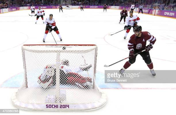 Lauris Darzins of Latvia scores a goal against Carey Price of Canada in the first period during the Men's Ice Hockey Quarterfinal Playoff on Day 12...