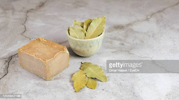 laurus nobilis ,aleppo soap is a handmade, hard bar soap or ghar soap made from olive oil and lye - syria stock pictures, royalty-free photos & images