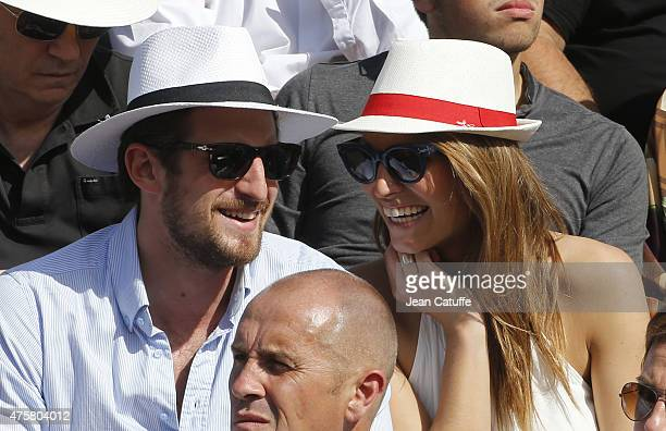 Laury Thilleman and her boyfriend attend day 11 of the French Open 2015 at Roland Garros stadium on June 3 2015 in Paris France