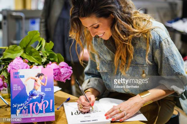 Laury Thilleman is seen during the launch event for Laury Thilleman's book 30 jours pour être au TOP at La Salle de Sport at Madeleine on May 14 2019...