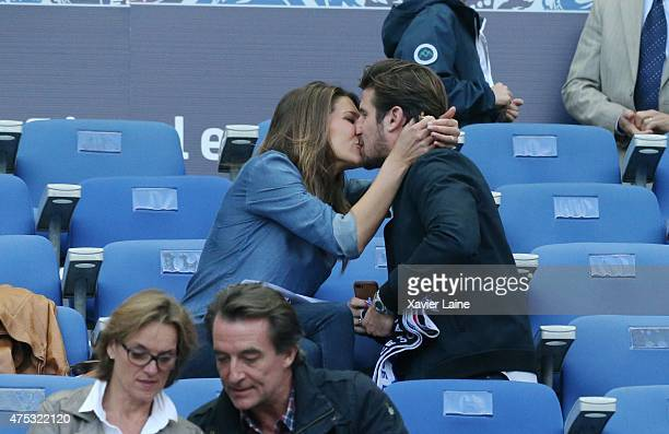 PARIS FRANCE MAY Laury Thilleman kiss Nicolas Tesic during the French Cup Final between AJ Auxerre and Paris SaintGermain FC at Stade de France on...