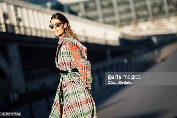 Laury Thilleman wears a multicolor checked trench coat black heels shoes outside Koche during Paris Fashion Week Womenswear Fall/Winter 2019/2020 on...