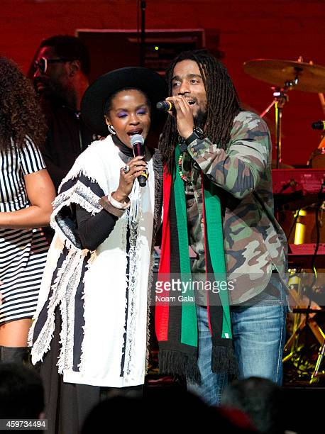 Lauryn Hill and Dwayne Anglin perform during The Wailers 30th Anniversary Performance at The Apollo Theater on November 29 2014 in New York City