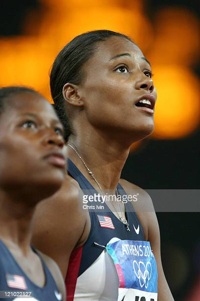 Lauryn Williams and Marion Jones react after the United States gets a DNF in the Women's 4x100m Relay Final in Olympic Stadium at the Athens 2004...