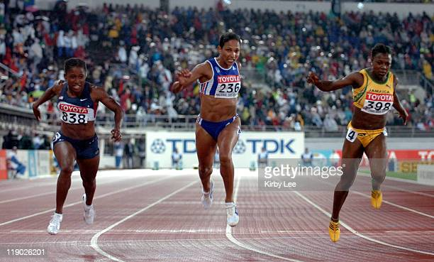 Lauryn Williams of the United States edges Christine Arron of France and Jamaica's Veronica Campbell to win the women's 100 meters in the IAAF World...