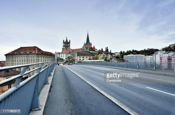 lausanne cityscape and cathedral of notre dame at sunset, switzerland - lausanne stock pictures, royalty-free photos & images