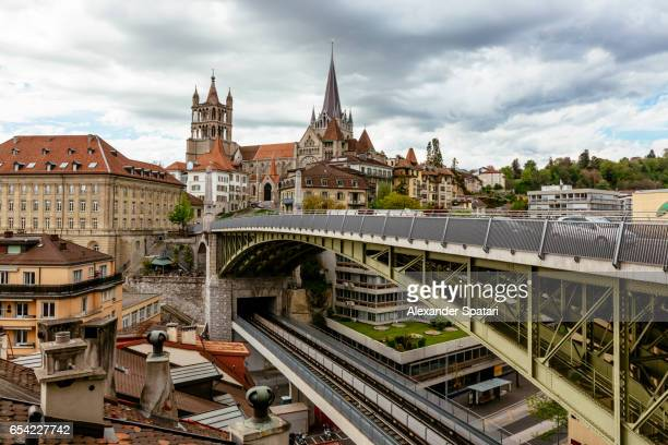lausanne cityscape with lausanne cathedral and bessieres bridge, switzerland - lausanne stock photos and pictures