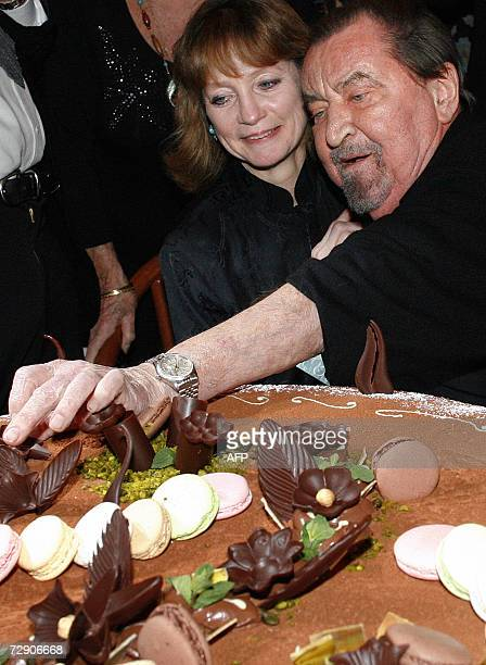 French choreographer Maurice Bejart with US former famous ballerina Suzanne Farrell look at his birthday cake while celebrating his 80th birthday 30...