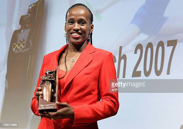 Sixtime Olympic medallist USA Jackie JoynerKersee smiles with the trophy she received during the ceremony of the 2007 International Olympic Committee...