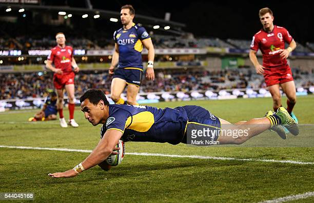 Lausii Taliauli of the Brumbies dives to score a try during the round 15 Super Rugby match between the Brumbies and the Reds at GIO Stadium on July 1...