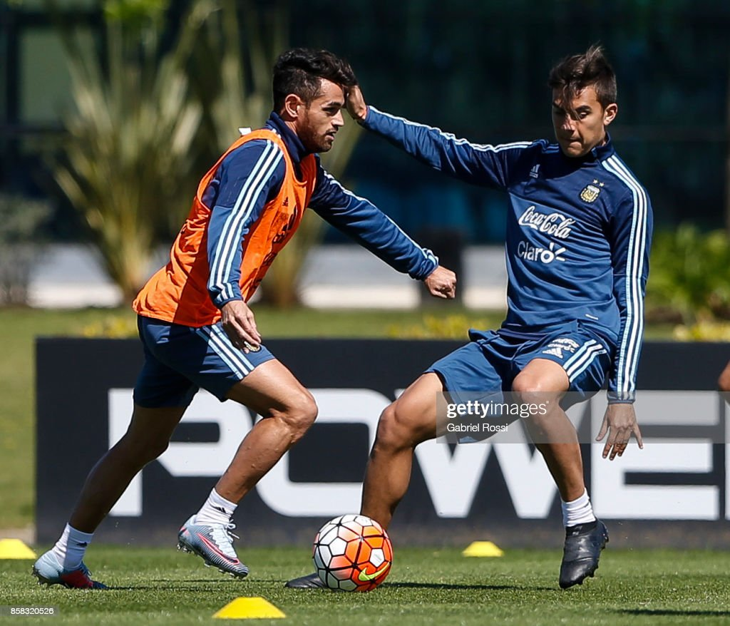 Lautaro Acosta of Argentina fights for the ball with Paulo Dybala of Argentina during a training session at Argentine Football Association (AFA) 'Julio Humberto Grondona' training camp on October 06, 2017 in Ezeiza, Argentina.