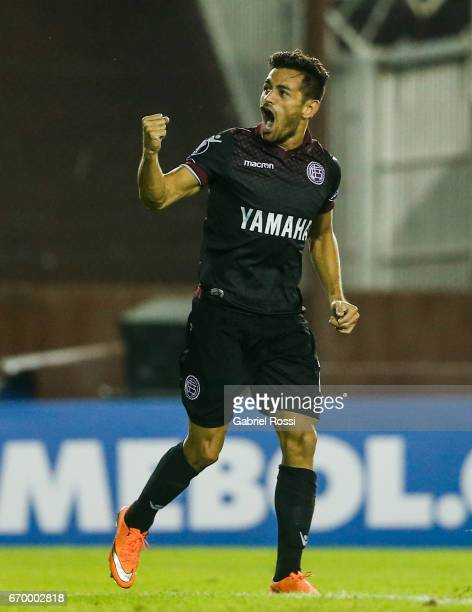 Lautaro Acosta of Lanus celebrates after scoring the first goal of his team during a group stage match between Lanus and Zulia as part of Copa...