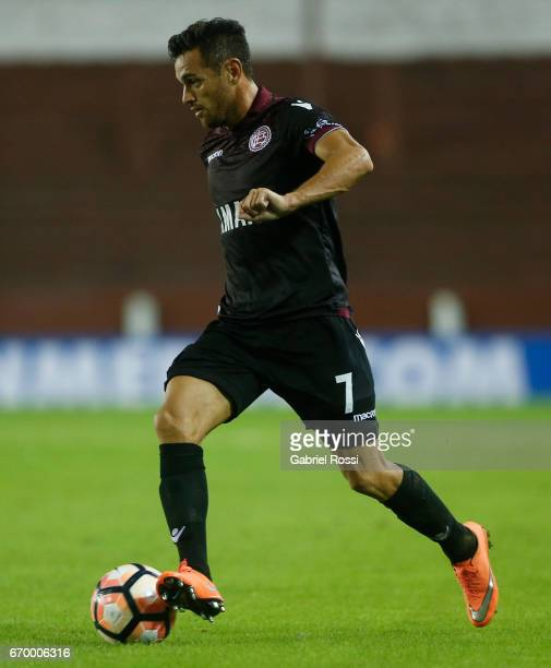 Lautaro Acosta of Lanus drives the ball during a group stage match between Lanus and Zulia as part of Copa CONMEBOL Libertadores Bridgestone 2017 at...