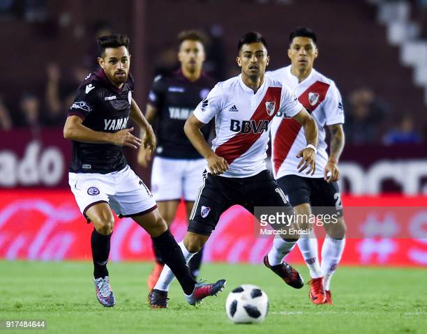 Lautaro Acosta of Lanus fights for ball with Gonzalo Martinez of River Plate during a match between Lanus and River Plate as part of the Superliga...