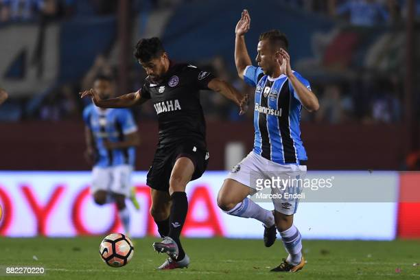 Lautaro Acosta of Lanus fights for tha ball with Arthur of Gremio during the second leg match between Lanus and Gremio as part of Copa Bridgestone...