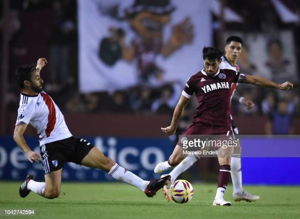 Lautaro Acosta of Lanus fights for the ball with Ignacio Scocco of River Plate during a match between Lanus and River Plate as part of Superliga...