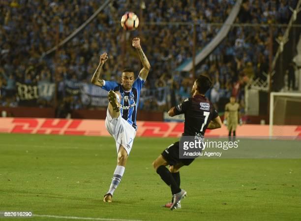 Lautaro Acosta of Lanus in action against Luan Guilherme de Jesus Vieira of Gremio during Copa Libertadores final match between Lanus and Gremio at...