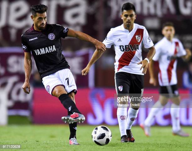 Lautaro Acosta of Lanus kicks the ball during a match between Lanus and River Plate as part of the Superliga 2017/18 at Ciudad de Lanus Stadium on...
