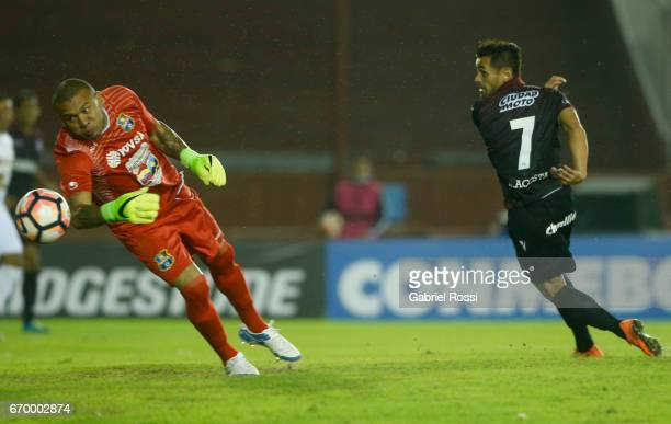 Lautaro Acosta of Lanus kicks the ball to score the first goal of his team during a group stage match between Lanus and Zulia as part of Copa...
