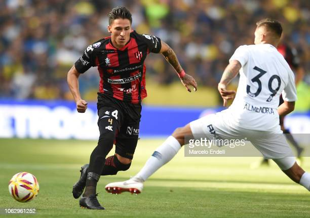 Lautaro Geminiani of Patronato kicks the ball against Agustín Almendra of Boca Juniors during a match between Boca Juniors and Patronato as part of...