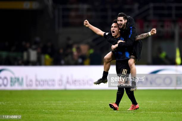 Lautaro Martinez and Matteo Politano of FC Internazionale celebrate the victory at the end of the Serie A football match between AC Milan and FC...