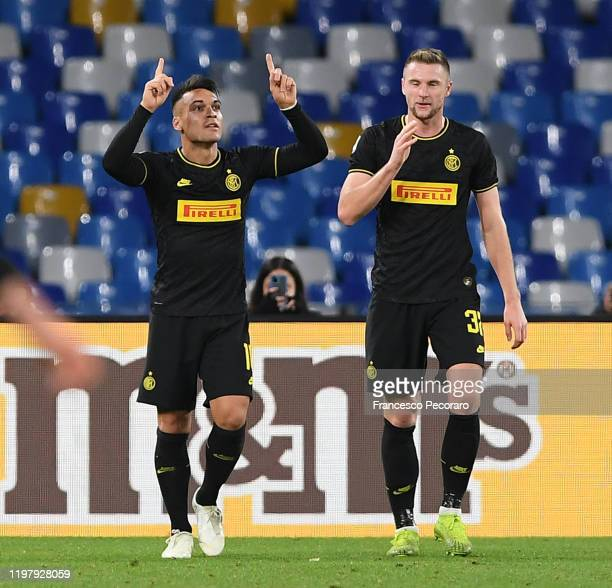 Lautaro Martinez and Milan Skriniar of FC Internazionale celebrate the 13 goal scored by Lautaro Martinez during the Serie A match between SSC Napoli...