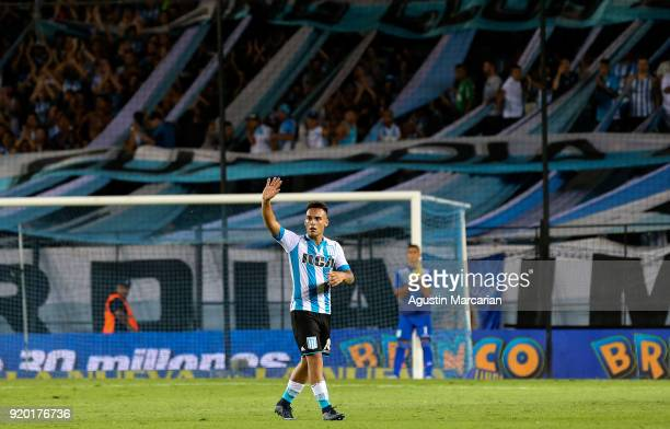 Lautaro Martinez greets the fans as he leaves the pitch during a match between Racing Club and Lanus as part of Argentine Superliga 2017/18 at...