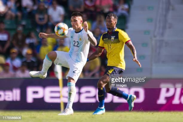 Lautaro Martinez of Argentina and Dario Aimar of Ecuador battle for the ball during the UEFA Euro 2020 qualifier between Ecuador and Argentina on...