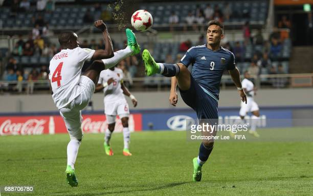 Lautaro Martinez of Argentina and Oumar Toure of Guinea challenge for the ball during the FIFA U20 World Cup Korea Republic 2017 group A match...