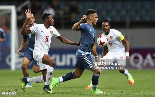 Lautaro Martinez of Argentina battles with Mohamed Camera of Guinea during the FIFA U20 World Cup Korea Republic 2017 group A match between Guinea...