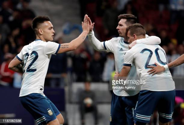 Lautaro Martinez of Argentina celebrates his goal with Lionel Messi and Giovani Lo Celso during the Friendly match between Argentina and Venezuela at...