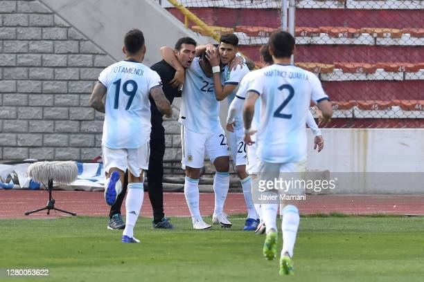 Lautaro Martinez of Argentina celebrates the first goal of his team with Lionel Scaloni and Exequiel Palacios during a match between Bolivia and...