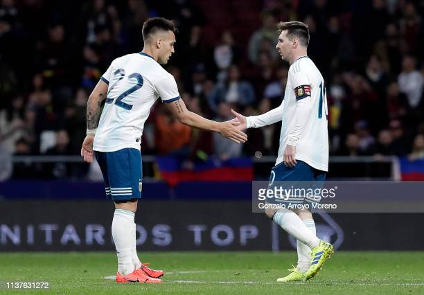 Lautaro Martinez of Argentina celebrates with Lionel Messi of Argentina after he scores his sides first goal during the International Friendly match...
