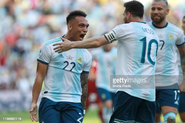 Lautaro Martinez of Argentina celebrates with teammate Lionel Messi after scoring the opening goal during the Copa America Brazil 2019 quarterfinal...