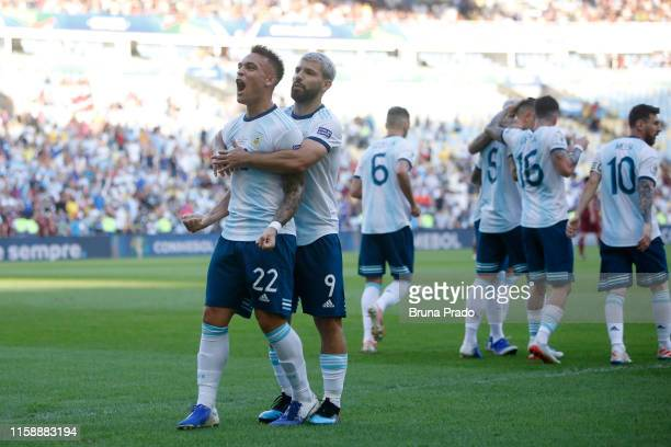 Lautaro Martinez of Argentina celebrates with teammate Sergio Aguero after scoring the opening goal during the Copa America Brazil 2019 quarterfinal...