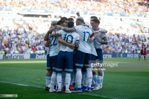 Lautaro Martinez of Argentina celebrates with teammates after scoring the opening goal during the Copa America Brazil 2019 quarterfinal match between...