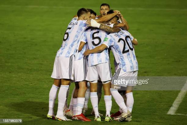 Lautaro Martinez of Argentina celebrates with teammates after scoring the first goal of his team during a match between Venezuela and Argentina as...