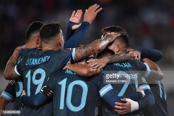 Lautaro Martinez of Argentina celebrates with teammates after scoring the first goal of his team during a match between Argentina and Peru as part of...