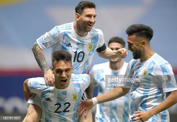 Lautaro Martinez of Argentina celebrates with teammates Lionel Messi and Nicolás Gonzalez after scoring the first goal of his team during a...