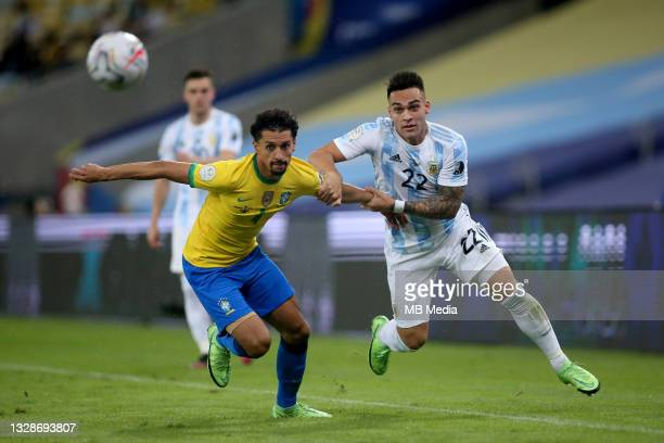 Lautaro Martinez of Argentina competes for the ball with Marquinhos of Brazil ,during the Final Match of Copa America Brazil 2021 between Brazil and...