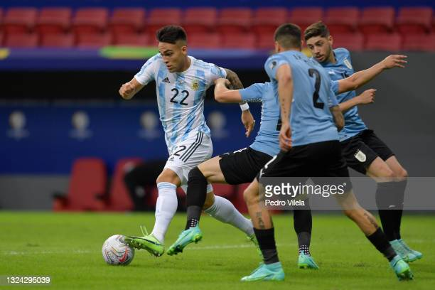 Lautaro Martinez of Argentina controls the ball against Federico Valverde of Uruguay during a group A match between Argentina and Chile as part of...