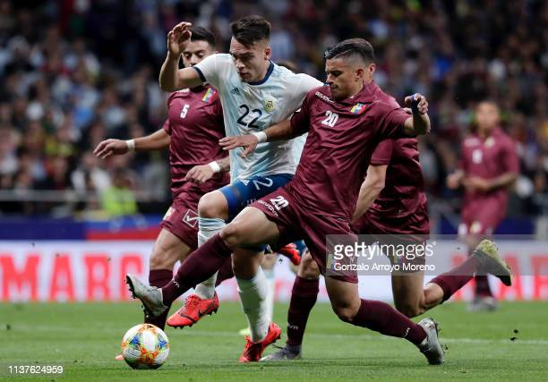 Lautaro Martinez of Argentina is brought down by Ronald Hernandez of Venezuela during the International Friendly match between Argentina and...