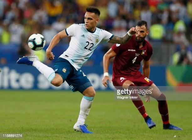 Lautaro Martinez of Argentina kicks the ball against Jhon Chancellor of Venezuela during the Copa America Brazil 2019 quarterfinal match between...
