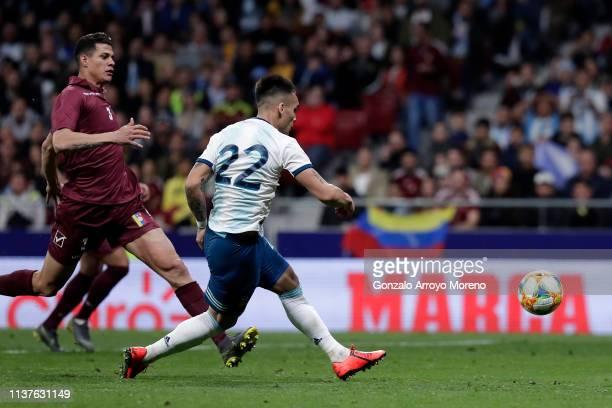 Lautaro Martinez of Argentina scores his sides first goal during the International Friendly match between Argentina and Venezuela at Estadio Wanda...